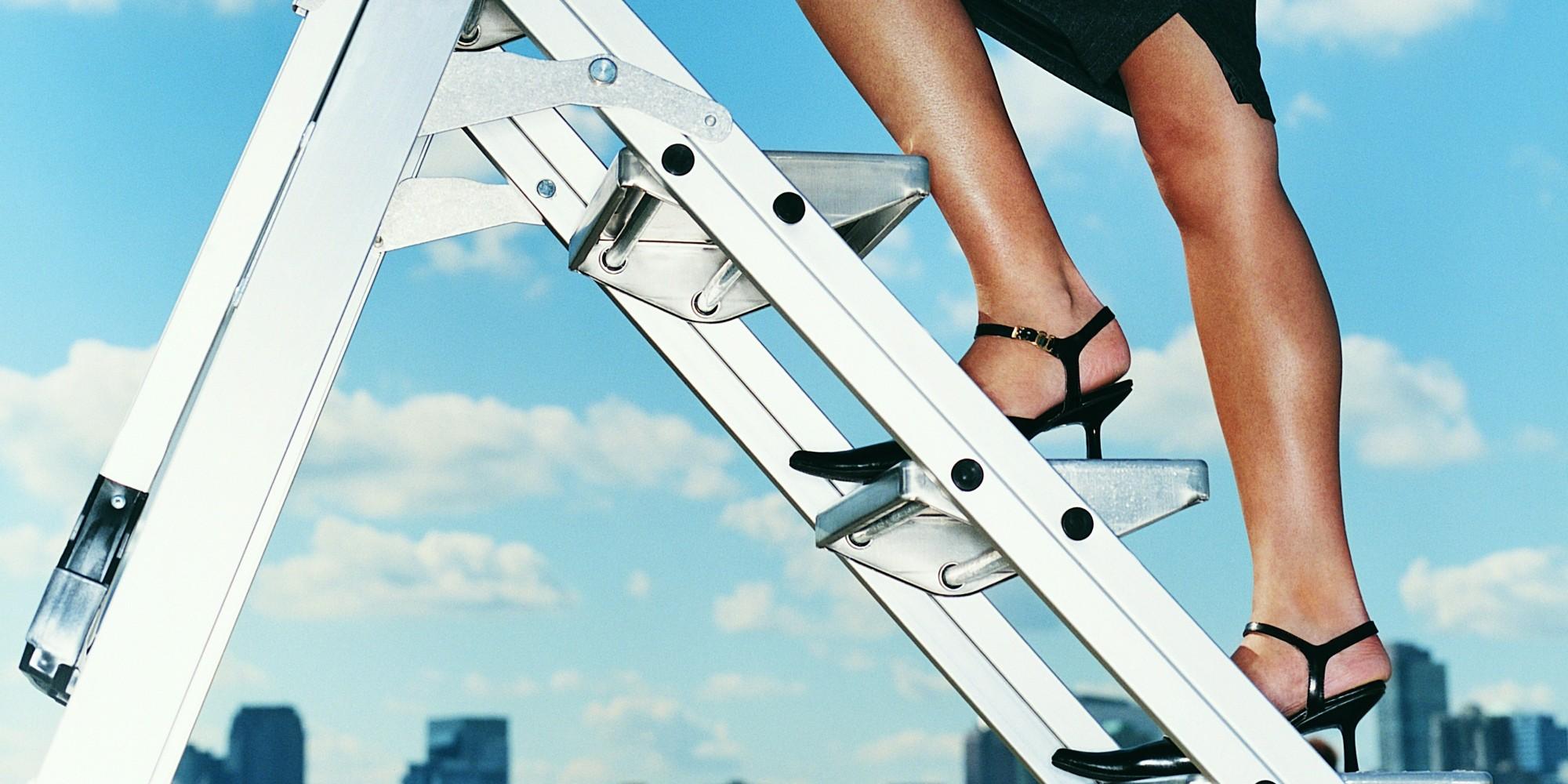 Businesswoman Outdoors Climbing a Stepladder